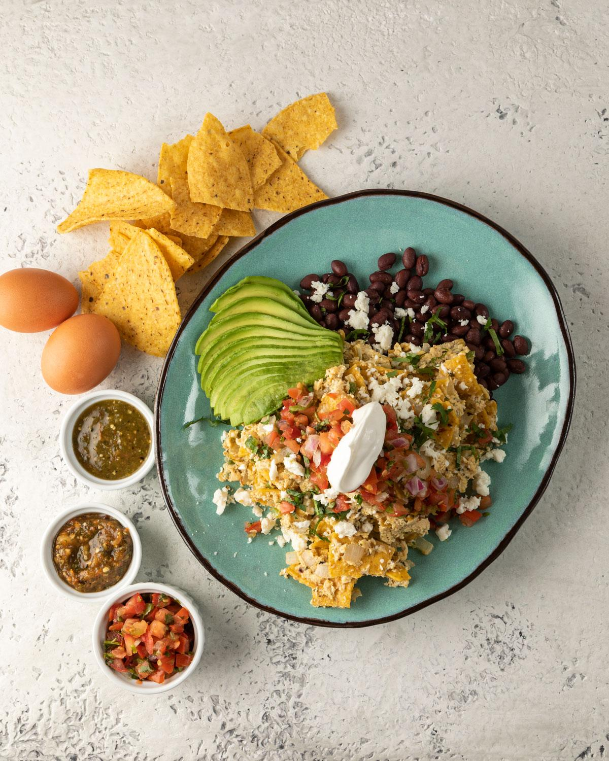 Migas with chips, salsas and avocado