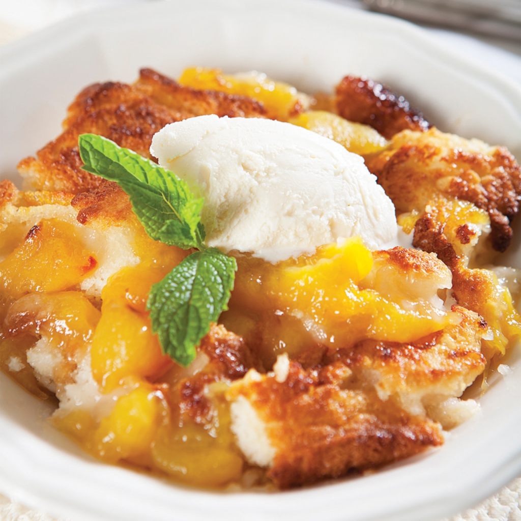 peach cobbler a la mode with a sprig of mint